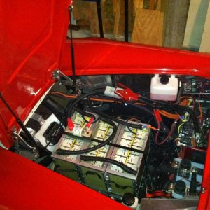Batteries, motor and motor controller under the hood